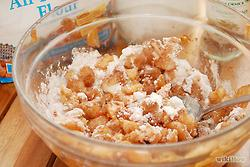 Dice and peel the lids very finely. Toss out the stems. Put the peeled and diced lid bits into the pulp bowl.  Mix the sugar, flour and ground cinnamon into the apple pulp until well blended.
