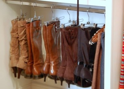 Use clip hangers to hang your boots up. It's organized and saves on space.