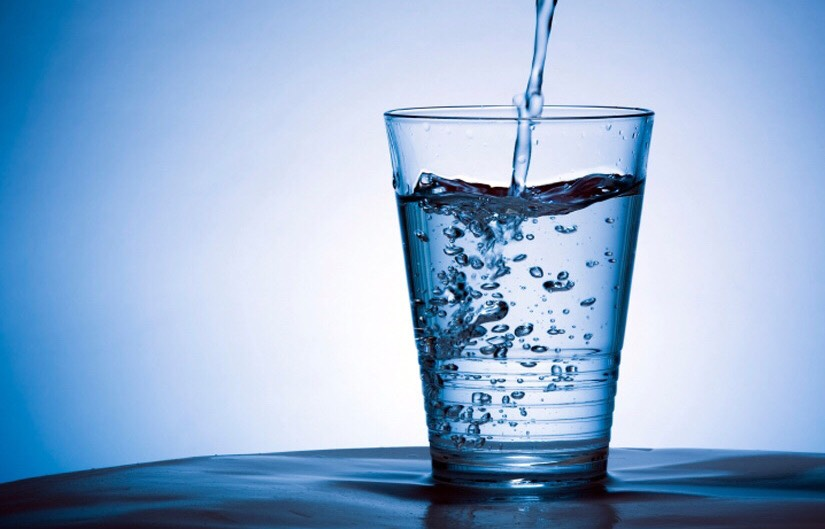 Drink two litters of water a day. This helps to get rid of toxins in your body and face and keeps all the vitamins in. Also makes you feel more awake during the day.