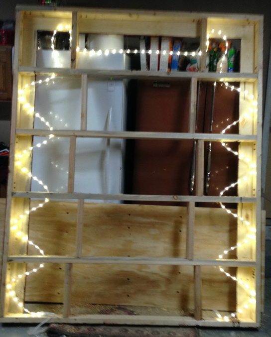 Holes were drilled and the LED rope lighting was snaked through the top bed frame for lighting
