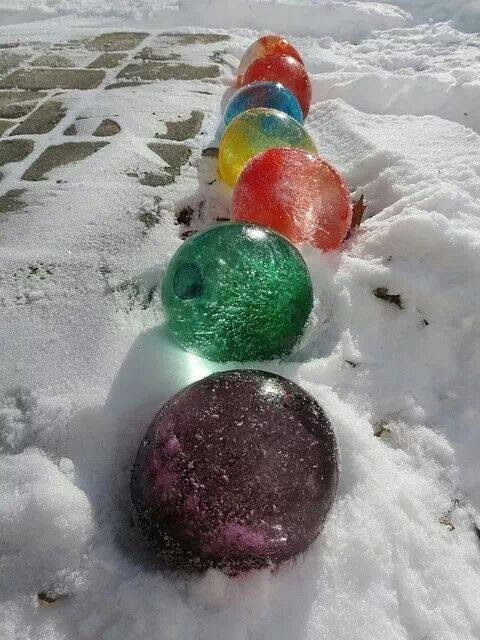 Tap for full view.....Fill balloons with water and food colouring. Freeze then pop! Pretty cool!