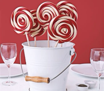 One part holiday spirit, two parts Willy Wonka, lollipop bouquets inspire childlike cheer at any table―and never shed petals. Pack a bucket with dry sand and arrange colorful pops in a loopy bouquet. The sand will keep them standing steady through dinner (unless a sweet tooth gets to them first).