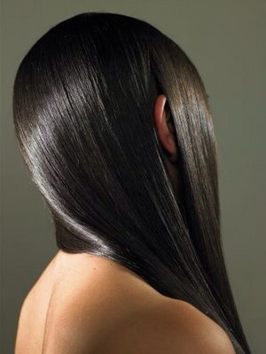 8. To add little shine to your hair: Smooth a tiny amount of coconut oil onto your ends to add a little shine, or on flyaways if you have dark hair. Remember that a dab will do you: Any more and your hair might appear greasy.