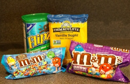 Gather your ingredients: • Vanilla Sugar Cookie Dough • Chocolate Pretzels  • Red M&Ms • Chocolate Chips