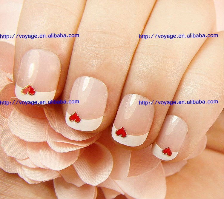 Wrap around area on nail where u want the heart...apply ur Fav combination color and remove carefully before completely dried...