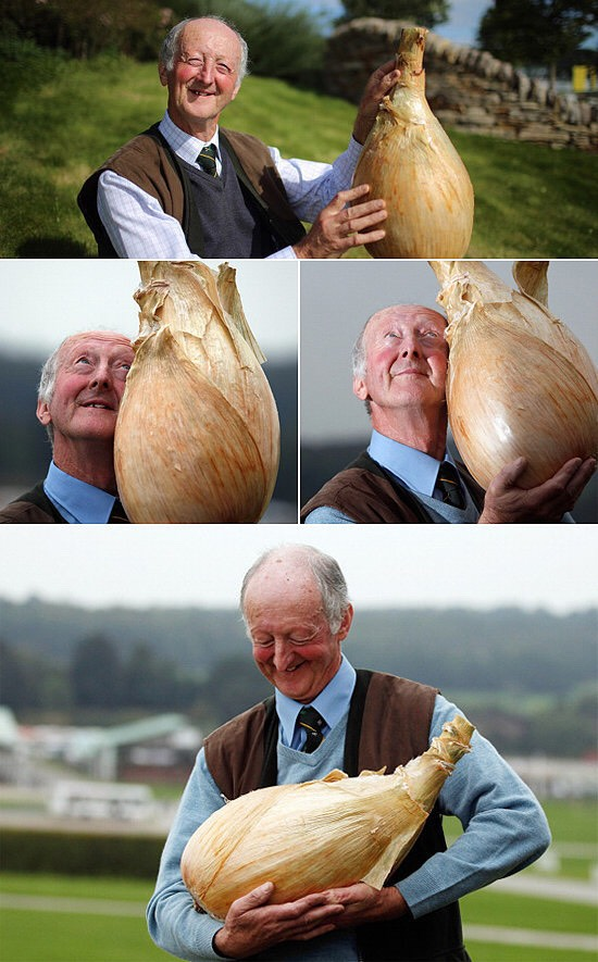 This man is so proud of his onion.