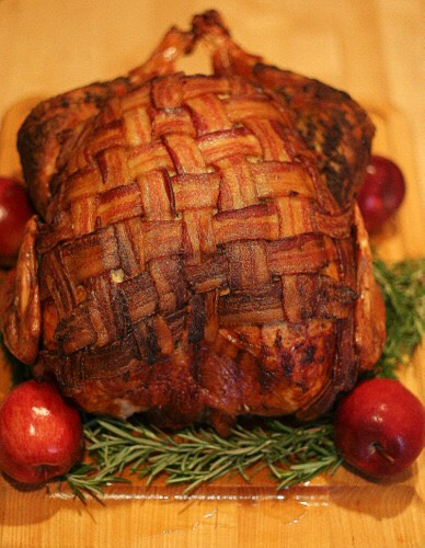 Ingredient: One 10-pound turkey 1 cup poultry seasonings 10 cloves garlic, minced 1 1/2 cups olive oil 1 pound bacon, sliced into thin strips