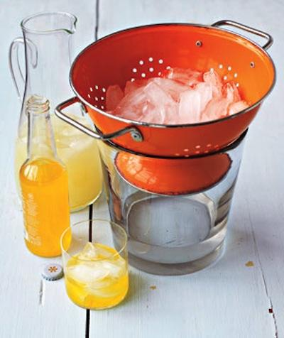 No more watered down drinks! Now your party guests can scoop ice while the water drains through the colander into a bucket or bowl below.