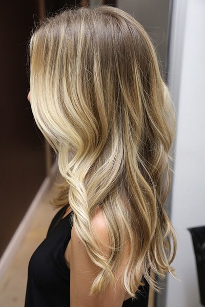 Dark blonde and light brown hair easily gets a boost from beachy golden highlights.