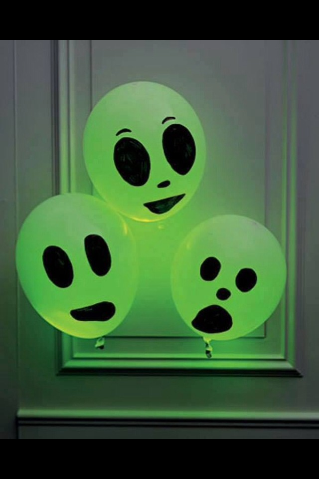 Use green glow sticks and draw on faces on balloons