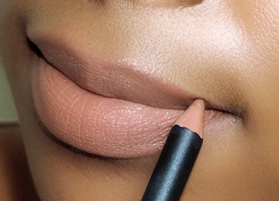 LINE YOUR LIPS  Don't ever skip this step! Lining your lips will help define your lips, contouring them to give you a pouty appearance. Nude lips can sometimes make your lips disappear and look deflated. Choose a nude liner that's one shade darker than your skin tone.