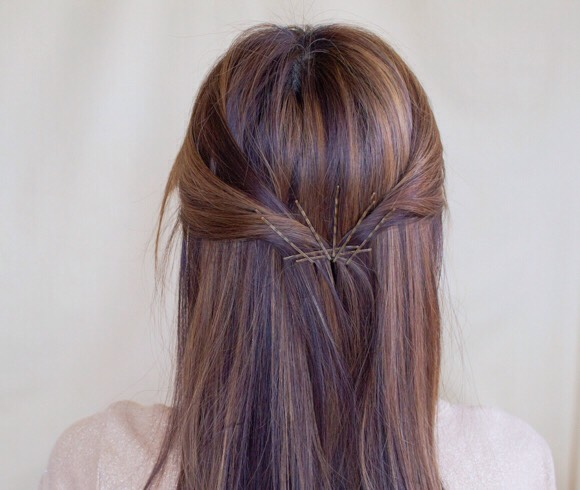 take 2 bobby pins to hold your hair together side by side, then add 5 more facing  upward