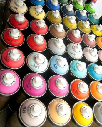 Spray paint each bottle to the colors of your choice.