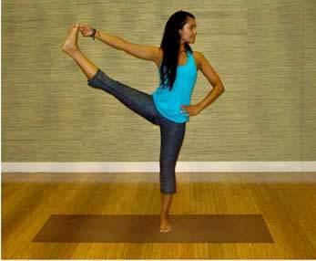 12. Standing Hand to Toe: Stand with your spine straight, feet together and hands on your waist. Lift your right leg straight up with your left leg's support. Hold for a few breaths and repeat with the other leg.