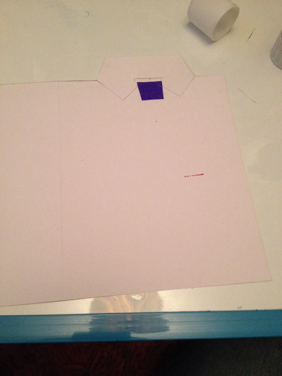 Cut a trapezium out from coloured card you like and stick it down