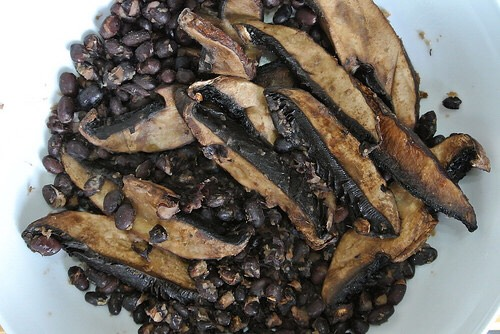 • 1/4 cup canned black beans (55 calories) • 1/2 cup canned mushrooms (20 calories) heat in pot. take off heat and add cayenne. total calories: 75 (can vary depending on black bean brand)