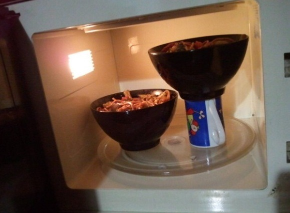 Place a bowl or plate on top of an upside down mug to microwave more than one thing at once