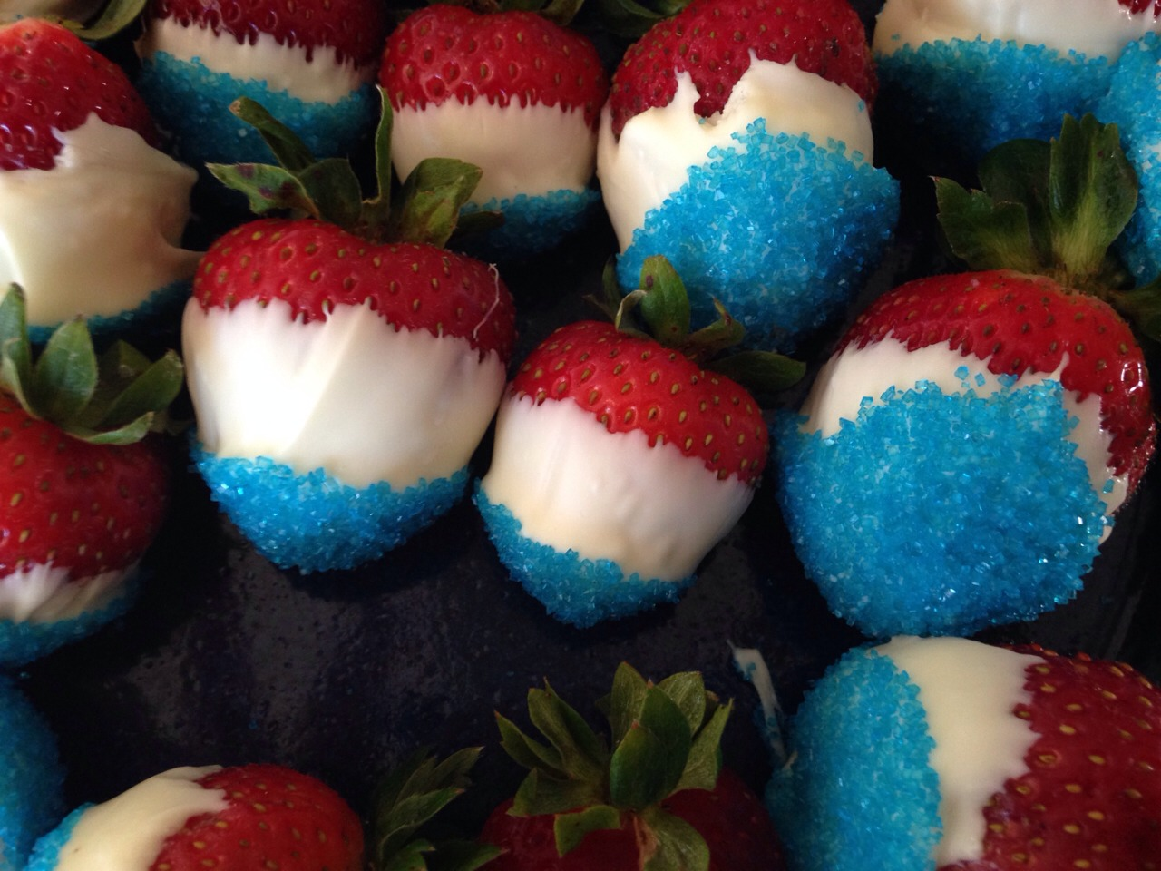 dip strawberries in white chocolate and then add blue sprinkles on the end. you could do this for other holidays by changing the colors