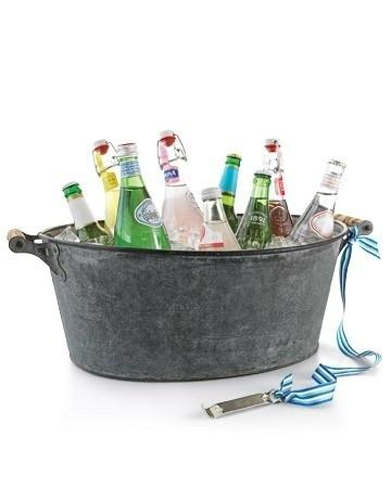 Tie a bottle opener to the handle of the drink tub or cooler.