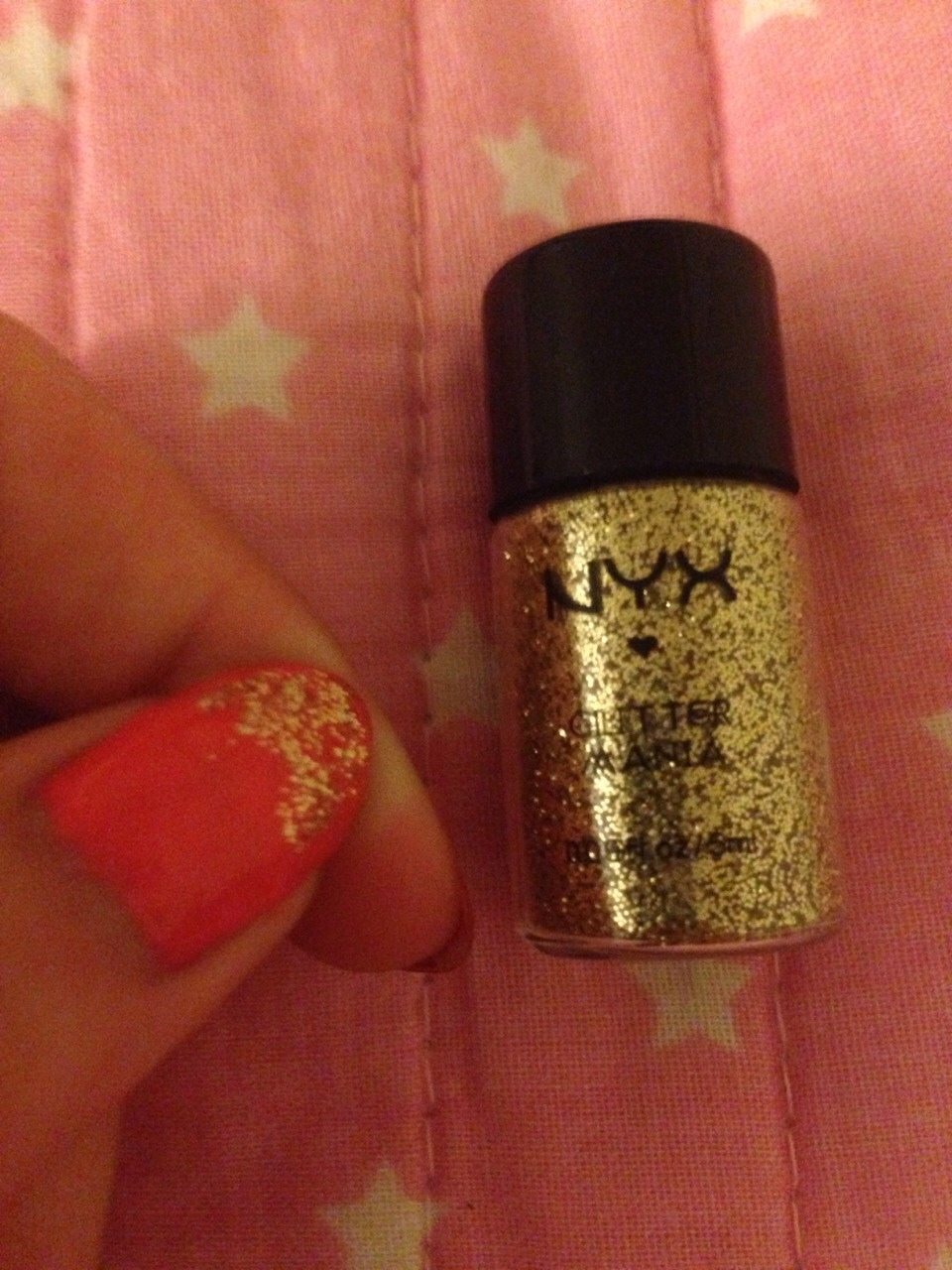 3) Now take your glitter makeup or finely cut glitter and apply it however you would like to on your nail while the last coat of paint you applied is still wet.