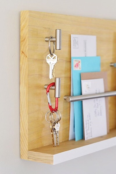 1. Knob Hooks  Knobs and pulls are easily converted into modern key hooks that you can proudly display near your front door.  Via Home Depot