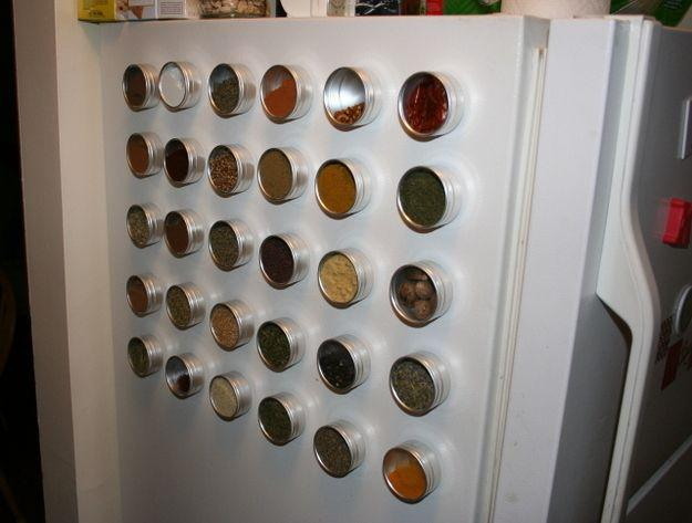Place magnetic spice holders on the side of your refrigerator