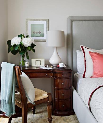 Traditional Elegance A dark wood desk with simple accessories gets prime placement in this bedroom, creating a space that's both functional and full of style.