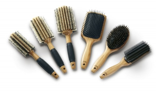 Use a natural bristle brush. The bristles are softer and often adds shine to your hair!