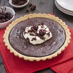 """Change up the classic Black Forest duo, cherries and chocolate, by layering the flavours in an easy pie. Decorate with whipped topping and chocolate curls for the full effect."""