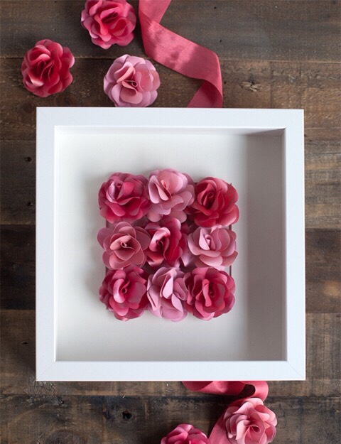 If you want to make this shadow box then glue them straight to your frame and skip the last two steps in the rose pin tutorial.