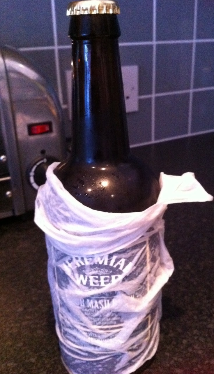 Wrap a wet piece of kitchen roll around a drink and put it in the freezer to make it ice cold