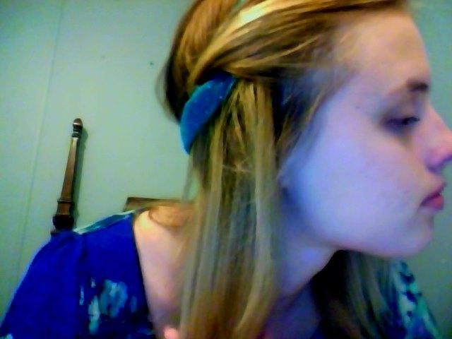 Step 4: Twist that strand of your hair into to headband! (Make sure you pull it all the way through so that you can continue twisting it along with the next strand!)