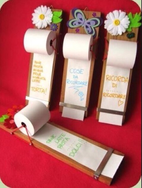 Easy and practical! All you need is a small piece of wood or any other board, commercial paper roll, some thread to hold the roll, an elastic band and some finition nails:)