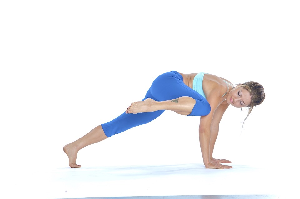 Plank side crunch: from the hand plank position bring your right knee around the side to touch your right elbow. Make it harder: do it from the forearms. You can twist the torso to engage both sets of oblique (side) ab muscles, just maintain tension, and be careful not to drop the hips to the floor.