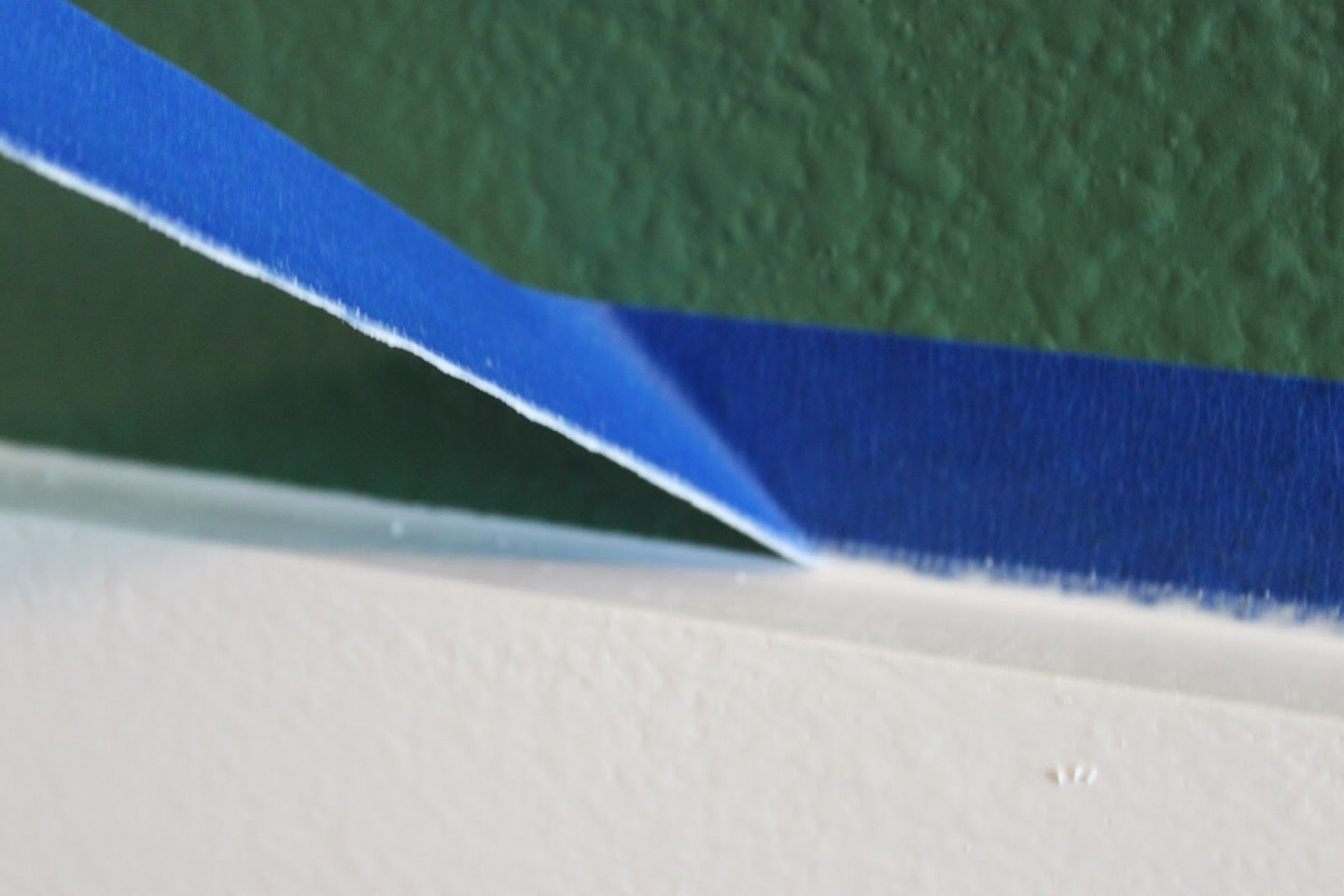 Slowly and carefully pull away painters tape