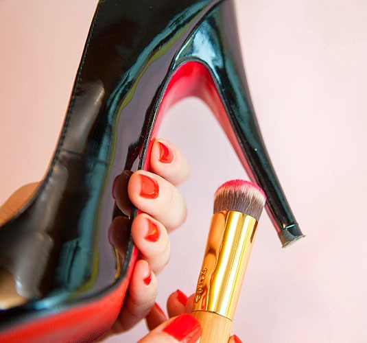 9. Use nail polish to add a pop of color to the sole of your shoe.