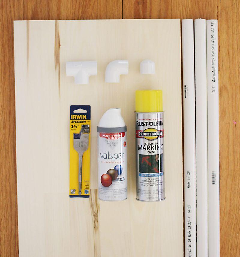 """Supplies you will need: -precut wood measuring 3/4"""" x 15"""" x 36"""" -spray paint in two colors -three 3/4"""" x 5' lengths of PVC pipe -super glue (not shown)"""