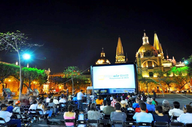 Some places have summer movies in the park for free check your local area to see when and where
