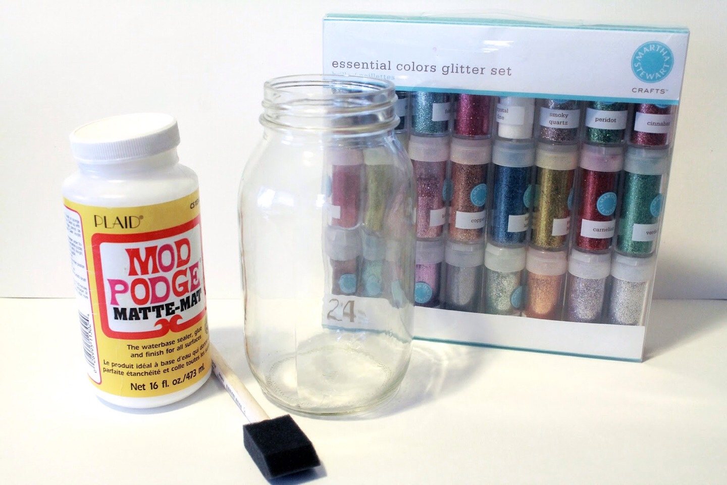 Paint the inside of a jar with PVA glue them tip glitter inside the jar. Put the lid on and shake until there is and even coverage and then tip the excess out.