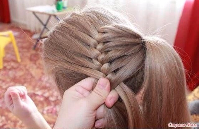 Continue braiding until all the small ponytail is braided in