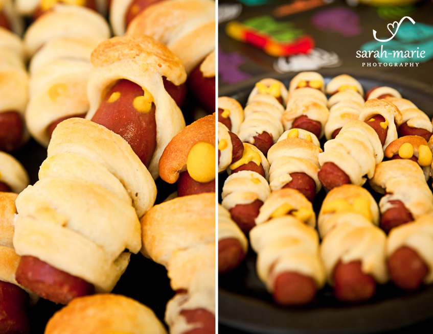 Wrap a crescent roll around some mini hotdogs like a mummy and cook them for a fun treat.
