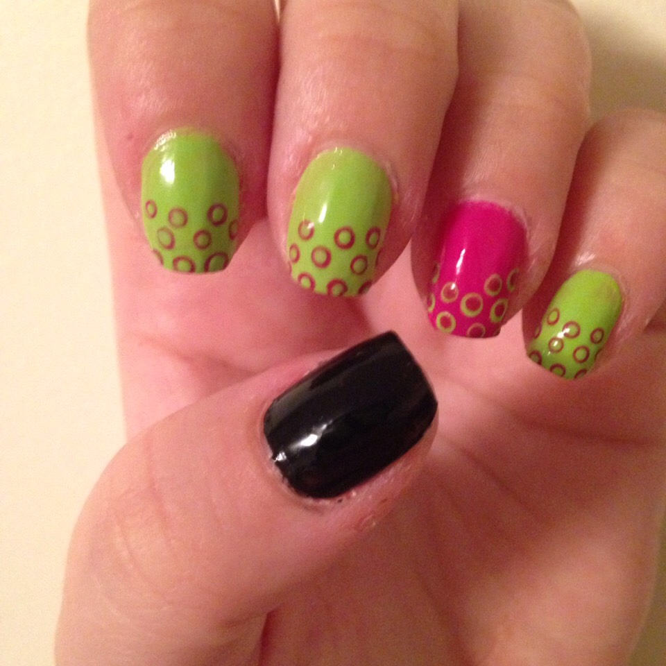 Black thumb , green nails with pink dots then smaller green dots , reversed on pink nail