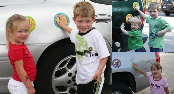 Place a safety spot sticker to your car where your children can place their hand on while you're loading/unloading the car. This will prevent them from wandering off.