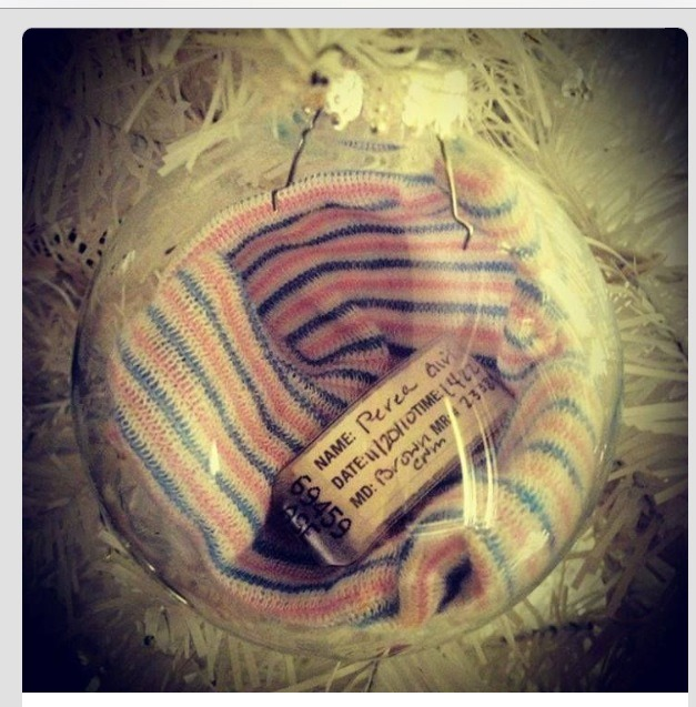 Put your baby's hospital beanie and bracelet inside a clear Christmas ornament! Cute idea for baby's first Christmas!