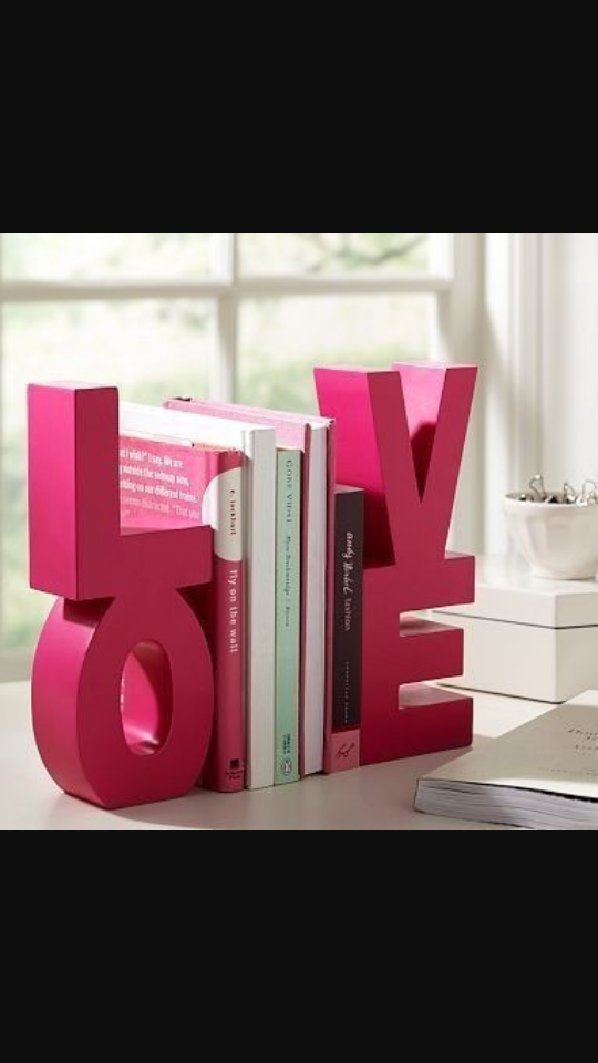 you can make or buy this at any store to make them cut out two of the L,O,V,E then make the sides and glue it togethet