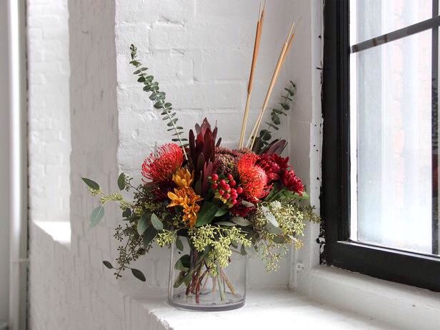 Low-Budget Blooms, High Impact Beautiful, inexpensive bouquets can be found at a local grocery store, ready for whipping up a perfect fall floral arrangement. This gorgeous arrangement bursts with fall color and was assembled in just a few minutes for a few dollars.