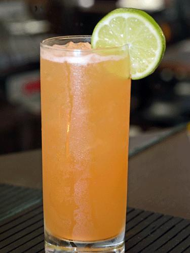 Golden Frizz  3 oz  Perfect Puree Mandarin Tangerine Puree 5 oz lime juice 1 oz agave nectar 1 dash Angostaura bitters Build in a highball glass. Stir ingredients mix and blend agave. Add ice to glass. Top with 3 oz Perrier Sparkling water.