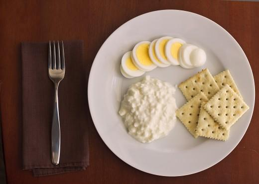 Day Two Lunch  1 cup cottage cheese (or 1 slice cheddar cheese) 1 hardboiled egg 5 saltine crackers