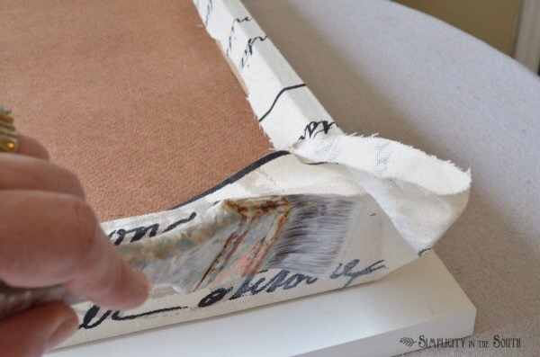 For the corners, add some Mod Podge before you fold and staple your corners like you're wrapping a gift.