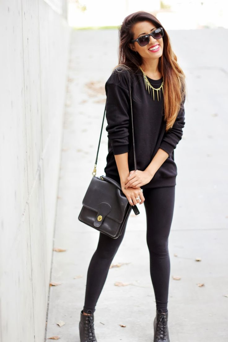 all black outfit with gold accents in accessories.